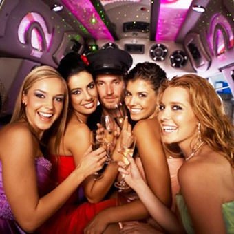 Hens night in limousine with happy young attractive people.
